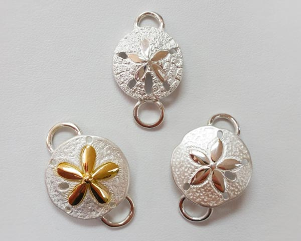 Two toned sand dollar clasps by Le Stage