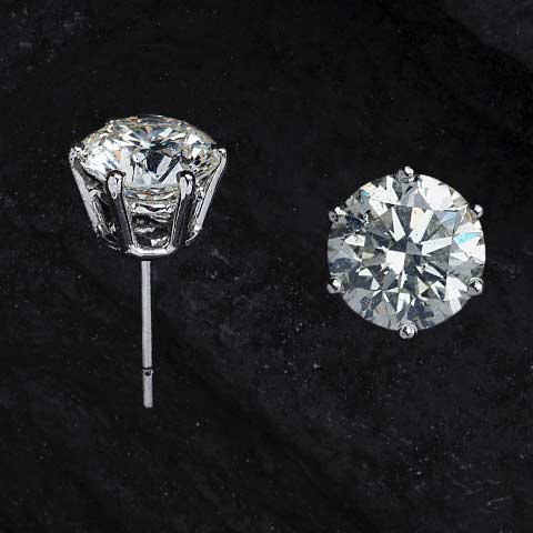 Diamon studs set on a post with black background
