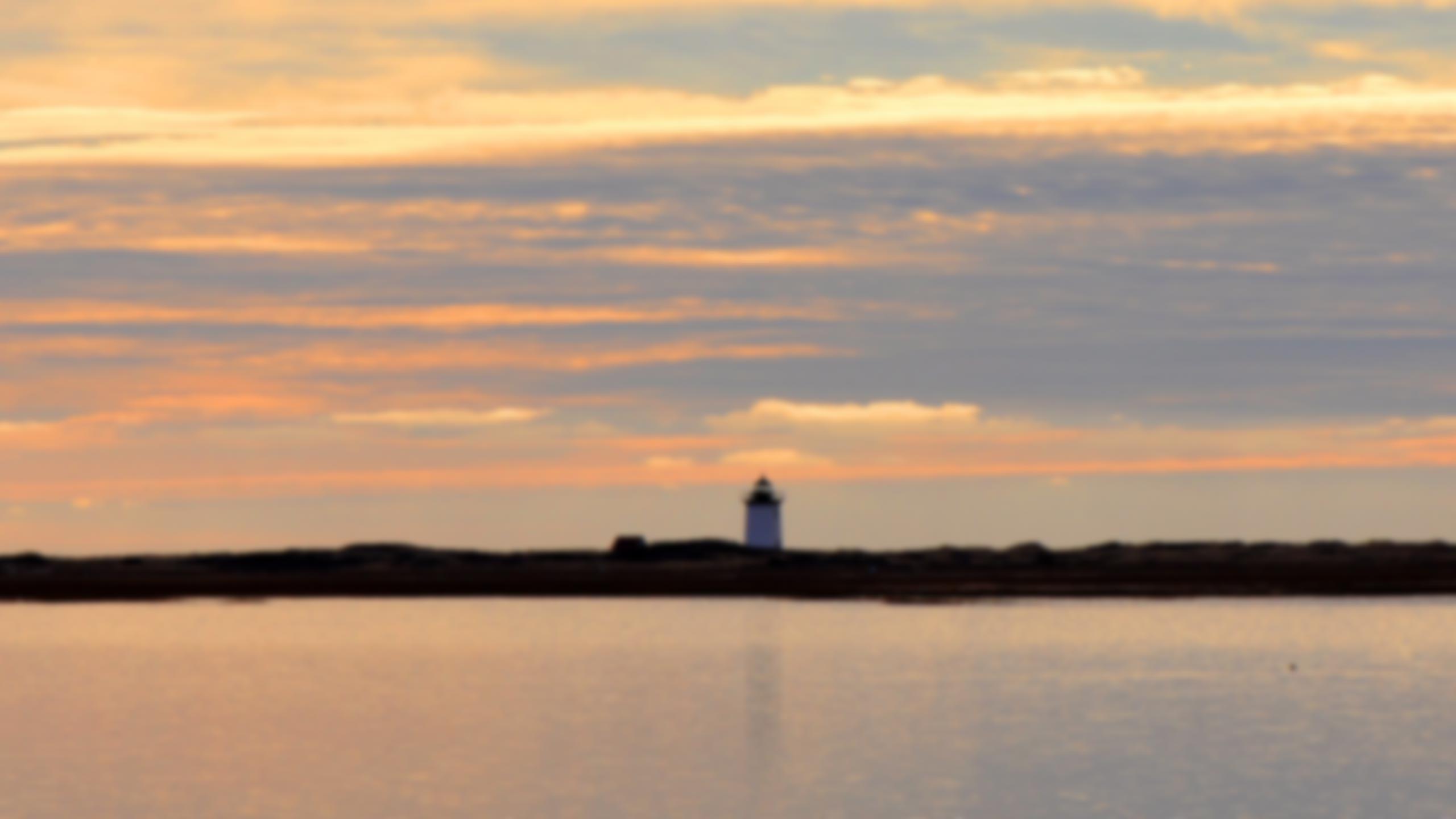 A lighthouse against a Cape Cod sunset